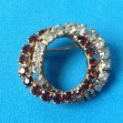 "Rhinestone  pin, clear & topaz - double circles  1"" x 1 1/4""."