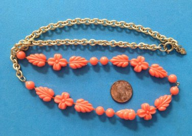 "Sarah Coventry necklace coral plastic, lightweight 24"" x 1/2""."