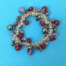 """Stretchy bracelet, red, lavender & dark gray stone silver tone  7"""" wrist."""