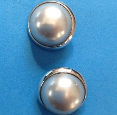 "Richelieu silver clip earrings with white center 1"" in diameter."