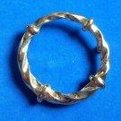 "Circle pin gold tone twisted design, vintage - 1 1/2"" diameter."