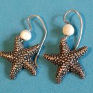 Pierced dangle earrings starfish & white stone in silver tone.