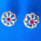 "Pierced earrings,gold tone, red center stone - 1/2"" in diameter."