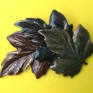 "Maroon & greens leaves pin 2 1/2"" x 1 1/2""."