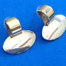 "Door knocker pierced earrings, gold & silver tone  1.25"" x 1.25"" reversible bottom piece."