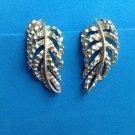 """BSK"" clip on leaf design earrings, soft gold tone."
