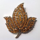 Pin - topaz colored rhinestone in gold tone - large, eye catching! Vintage.