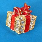 """Rhinestone pin, Christmas present in gold tone with red enamel  @ 1.5"""" x 1.5""""."""