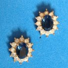 """"""" Roman """" pierced earrings. Sapphire blue stone with clear stone surround ."""