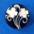 """Mourning Pin - black & white flowers in clear acrylic. 1 1/2"""" diameter"""