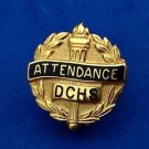 Gold tone attendance pin from Dominican Commercial High School 1940's.