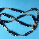 """Beaded necklace, gold tone & black faceted beads 26"""" long."""