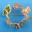 """Enamel circle pin butterfly & flower  @ 2 1/2"""" diameter x @ 5/8"""" wide."""