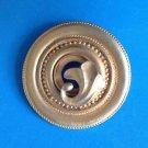 "Gold tone circle pin with satin finish  @ 2 1/8"" in diameter""."