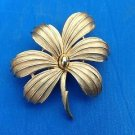 "Trifari pin, gold tone flower, satin & shiny finish. 2"" x 2"""