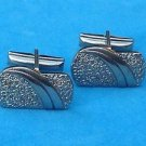 Silver tone cuff links. Handsome - textured and shiny .