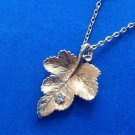"""Avon gold tone pendant necklace,  leaf with clear stone 16"""" long."""