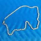 "Faux white pearl necklace 24"" long"