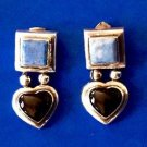 Sterling silver lapis and onyx dangling heart earrings.