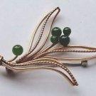 Jade & gold tone? Krementz flower pin.