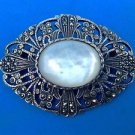Sterling silver marcasite & mop mother of pearl heavy pin. A large vintage piece.