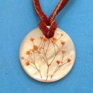 Real flowers in acrylic pendant on brown leather cord necklace.