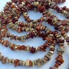 Lovely light weight earth tone tumbled stone necklace.