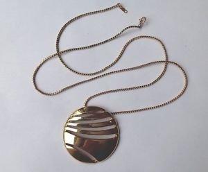 "Vintage Monet gold tone modern design disk pendant on 24"" Lenox chain."
