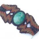 Artist made earth tone macrame blue green stone bracelet.