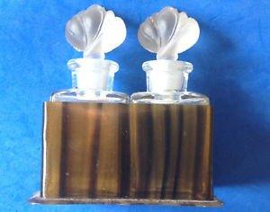 Pair of Art Deco lotus top perfume bottles in tortoise shell plastic box - antique