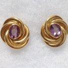 18k amethyst pierced earrings. Yellow gold, love knot design. Marked 750