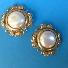 Clip on earrings,gold tone, white center . Large and lovely.