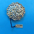 """Crown Trifari pin gold tone. Modernist style, new with tag 1 7/8"""" diameter."""