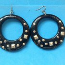 "Dangling pierced earrings.  2 3/8"" diameter black, plastic studded - fun 1960's."