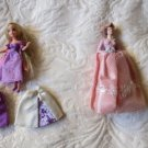 Lot Of 4 With Two Dolls And 2 Additional Skirts Unknown maker