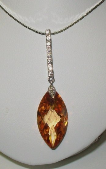 IMPERIAL TOPAZ COLORED CZ ELONGATED OVAL PENDANT WITH SILVER AND WHITE BRILLIANT CZ ACCENTS NEW