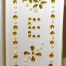 INITIAL JEWEL STICKERS BY GANZ PEEL AND STICK NEW LETTER E GOLD AND WHITE PEARL CRYSTALS