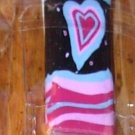 CRYSTAL NAIL FILE RED BLUE PINK STRIPE WITH MATCHING HEART AGAINST BLACK BACKGROUND IN CASE NEW GANZ