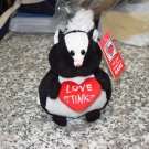 LOVE STINKS SKUNK BLACK AND WHITE PLUSH STUFFED ANIMAL HOLDING HEART NEW GANZ