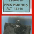 "SOUVENIR CHARM: marked JAPAN  ""I MADE IT"" PIKES PEAK COLORADO"