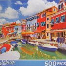 Puzzlebug Colorful Vibrant Houses Along a Boat Lined Canal in Burano, Venice, Italy