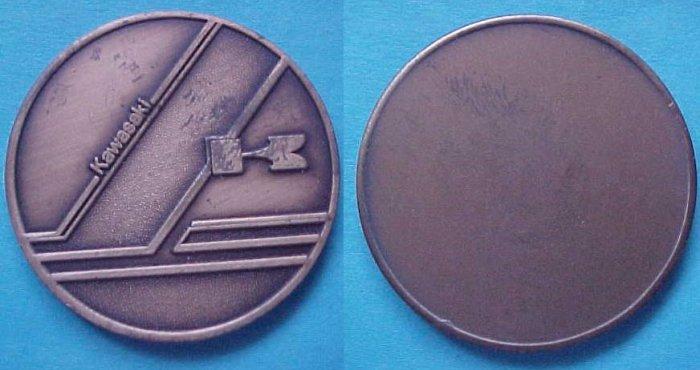 stylish Kawaski motorcycle medal, undated