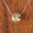 Two-Tone Gold Scroll Engraved Barrel Pendant