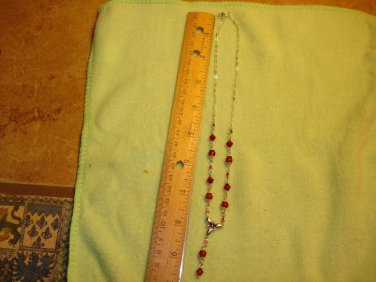 Necklace with glass beads and red tiny rhinestones.