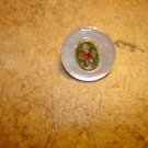 Vintage mother of pearl button with tiny red rhinestone.