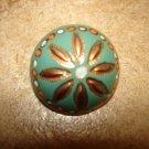 Art nouveau dome shape metal button.