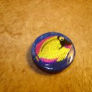 Lovely plastic button with colorful ocean fish