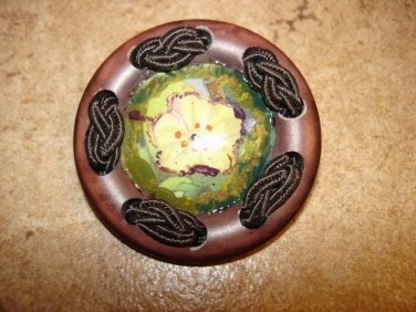 Extra large plastic button with silk brade and yellow flower.
