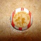 Silver metal advertising button for King Arthur flour.
