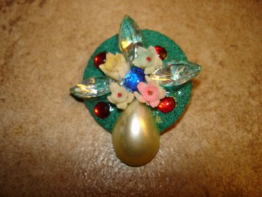 Signed metal button with glass beads, pearl, flowers and rhinestones.